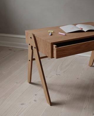 With the elegant design, the Geo Table will fit beautiful into any children's room, with storage space under the desk.   #wedowood #kidsroom #sustainabledesign #desk #homedecor #childrensroom #modernliving 