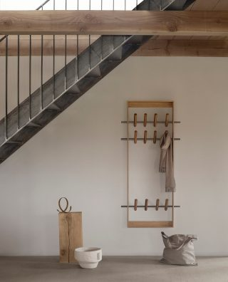 The Coat Frame is designed with elegant lines with room for storage of your coats and scarves,  while it still becomes a decorative piece in the entrance.   #wedowood #hallway #sustainabledesign #modernliving #homedecor #smallliving